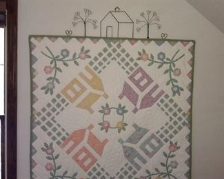 Several quilts and quilt stands