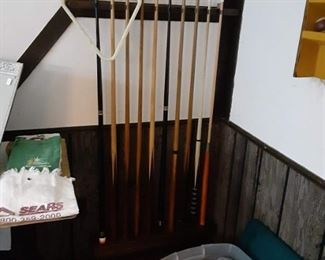 Pool cues and rack for antique pool table