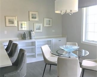 Counter height stools, small dinette set, wall art.