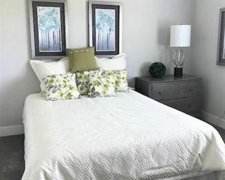 Bed (size avail soon), small 3 drawer dresser, pillows, bedding, wall art.