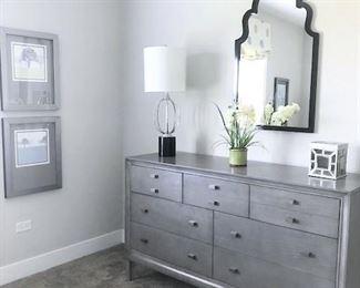 Dresser, mirror, lamps, home decor, wall art.