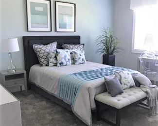Bed (size avail soon), bench, ghost chair, nightstands, wall art.