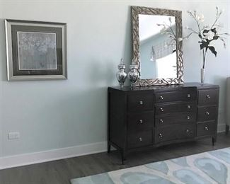 Dresser, mirror, area rugs.