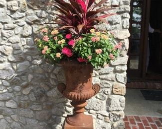 Cast iron urn   There are 4 and professional movers highly recommended