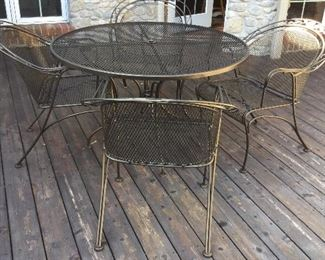 Wrought round patio table and chairs