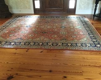 Area rug in persimmon, terra cotta, and blues 8'x10'
