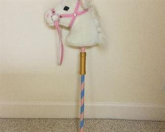 Mellisa and Doug unicorn stick horse