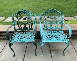 151. Antique Cast Iron Side Chairs