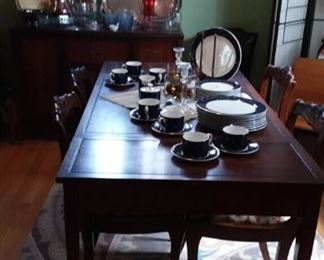 Lovely set of Dinnerware; Area Rug; and Mahogany Dining Table & Chairs by Grand Rapids Furniture Company.