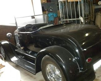 1928 FIBERGLASS BODY ROADSTER MOTOR 350 CHEVY W/NARROWED REAR END PRICE:$22,000
