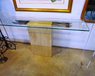 Very minimalist console table.  Heavy glass top on marble base.