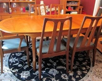 NATHAN DINING TABLE AND 6 CHAIRS WITH LEAF EXTENED.