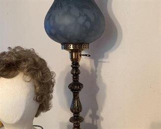 Very tall, beautiful blue lamp.