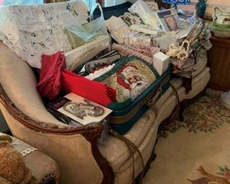 These are loads of table runners, place mats, runners, and two suitcases full of brand new sets of curtains.  Bring your measurements because you can find it here.