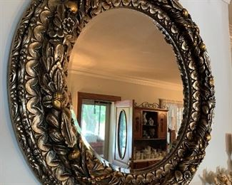 This mirror is amazing, and not as heavy as it looks.