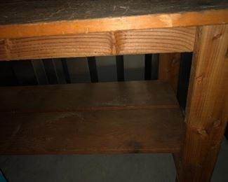 bottom shelf on workbench