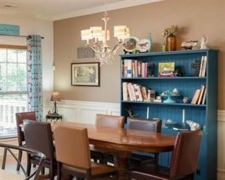 Stylish and modern best explains this Dining Room. Our three-shelf repurposed solid wood Turquoise Hutch is stylish and functional. Featured with a beautiful Oak Table and Leather Chairs makes this stylish blend work with this country charm home.