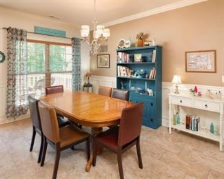 Closer look at the beautiful Dining Room featuring Turquoise Hutch, Off-White Serving Table, with Oak Dining Room Table Set off with Leather Parsons Chairs.