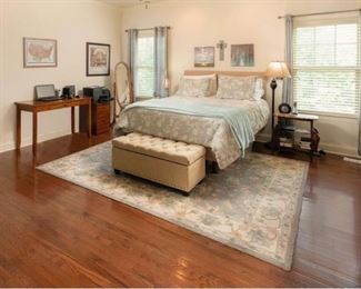 Master Bedroom with Queen Size Bed features a Raised new mattress, Area Rug, Storage Bench with Storage so much more.