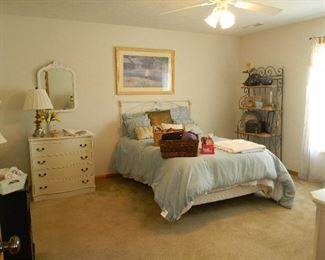 Iron bed has foot board and side rails not shown~ Complete bed and mattress does not include bedding)
