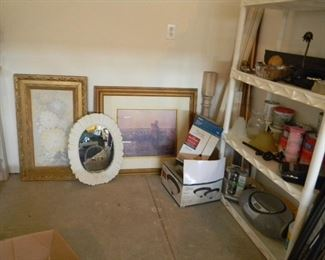Assorted frames and prints and curtain rods