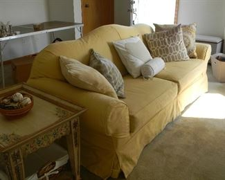 $68 Sunny yellow couch is slip covered with a wine colored fabric underneath~ $68