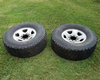2 Nitto Terra Grappler All Terrain Tires and wheels - LT325/70R17
