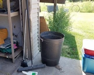 trash cans and brooms