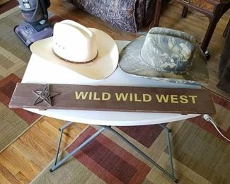 2 cowboy hats and wild wild west sign