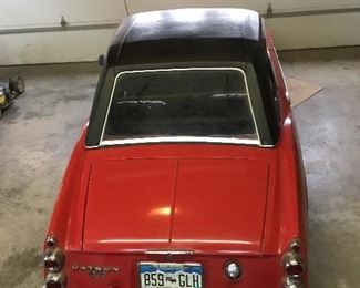 Only one owner, has driven this red/black 69 Datsun Roadster.