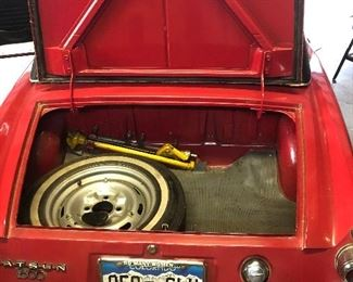 """Even the """"Boot"""" trunk of this 1969 Datsun Roadster is clean and ready for that Sunday afternoon drive in the country."""