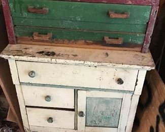 He housed many of his tools in this custom made primitive tool box cabinet.