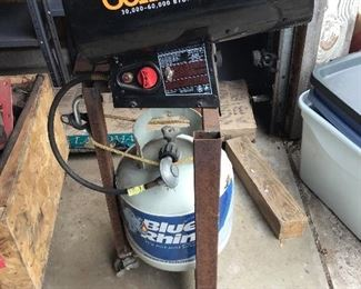 Mr. Heater with propane tank setup on a custom made metal stand.