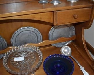 Pewter plates and serving pieces