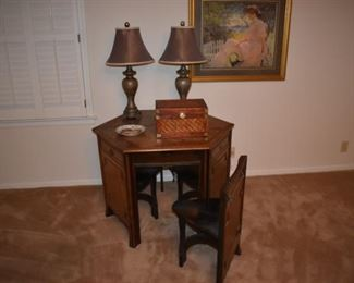 Very cool antique table and hide-away chairs