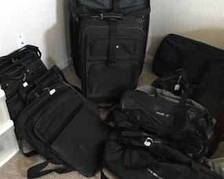 Nice luggage and brief cases.  Several all leather - Kenneth Cole and Wilson.