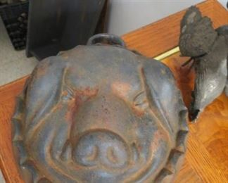 Cast iron pig head mold.