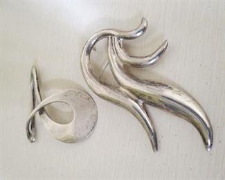 Large sterling silver pendants.