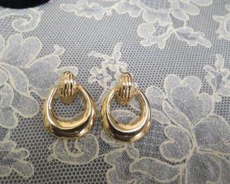 14k gold pierced earrings.
