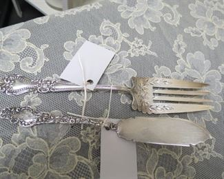Old sterling silver serving pieces.