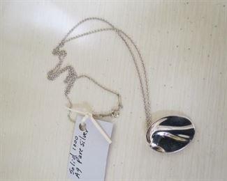 Tiffany & Co., silver Peretti Aquarius zodiac pendant necklace.