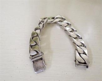 Men's sterling silver heavy curb bracelet.