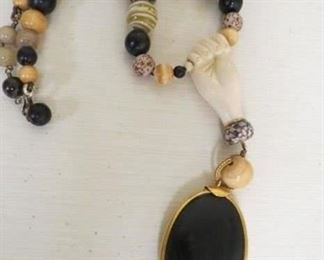 Unsigned carved hand necklace.