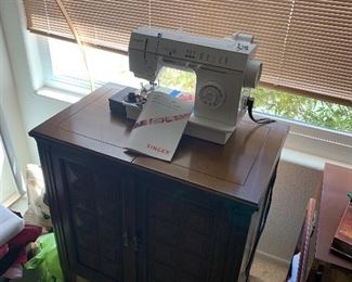 SEWING MACHINE SOLD! There is actually another sewing machine inside this sewing cabinet.