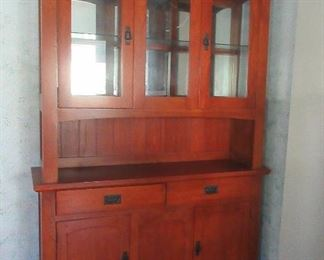 The china cabinet has lights inside of top and cast iron hardware.