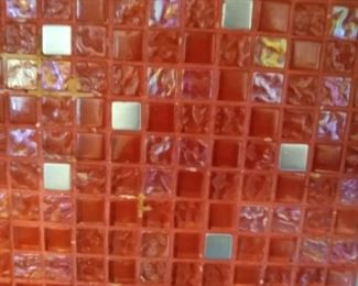 Glass tile in boxes left over from her kitchen project.
