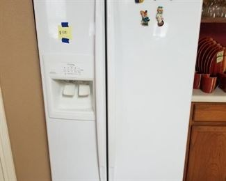 Whirlpool Gold Refrigerator with water dispenser and ice maker.  36 inches,wide, 70 inches tall, 30 inches deep.