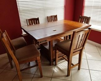 60 inch long, solid wood table with center leaf,  center storage drawer and 6 chairs.