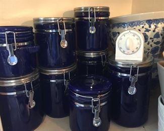 Set of cobalt blue canisters.