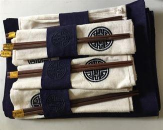 Set of Asian Napkins, placemats and chop sticks.